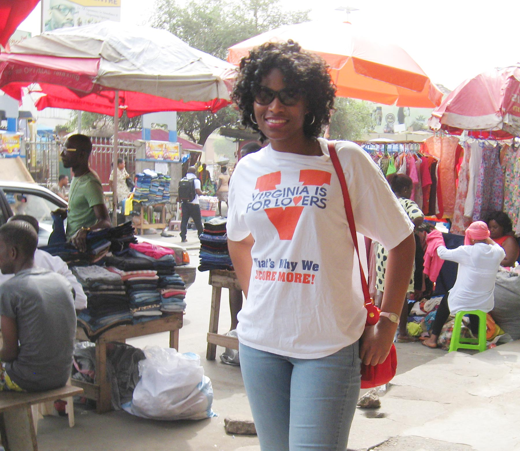 Genevieve poses in front of market in Ghana