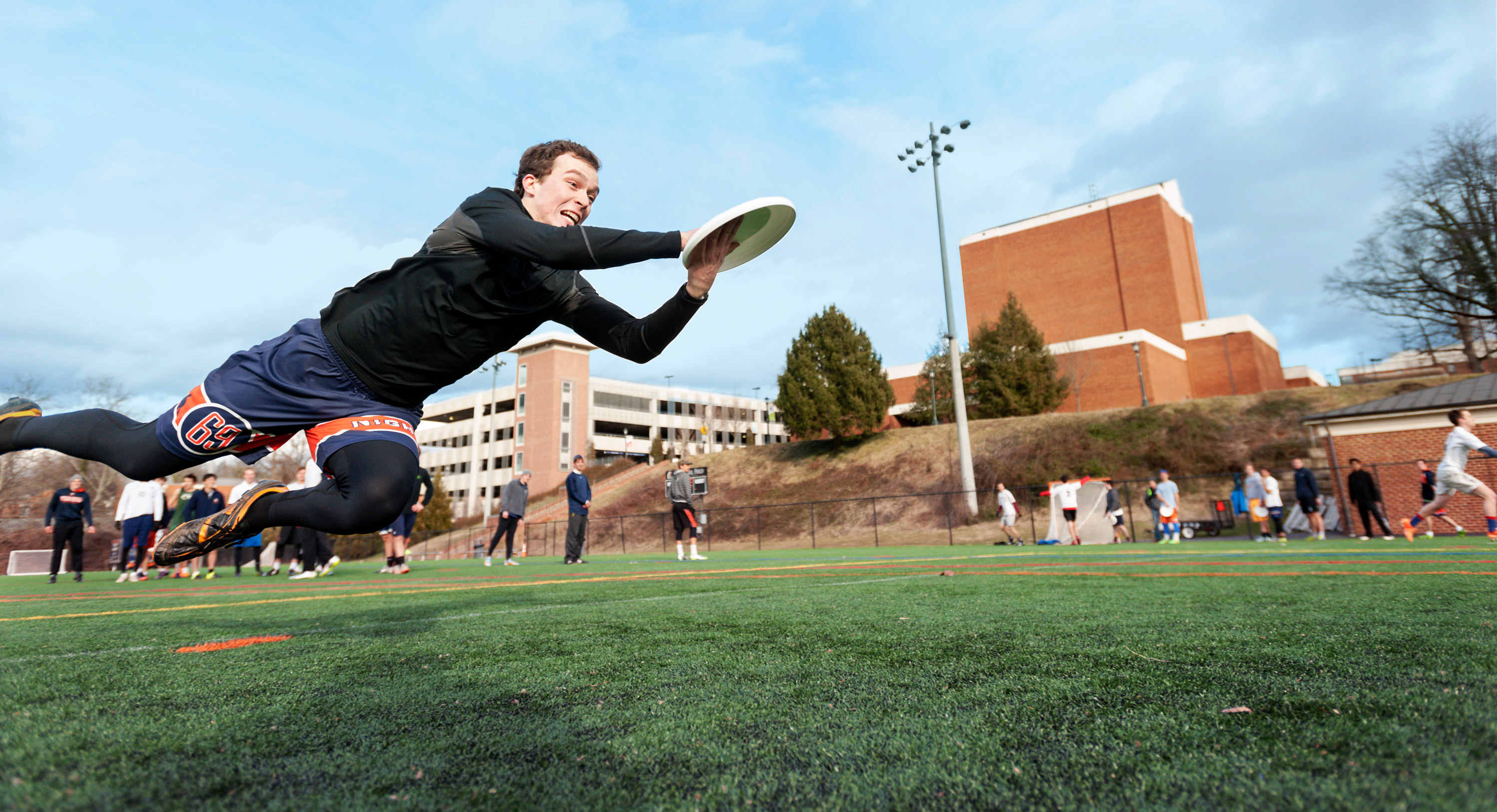 Student playing ultimate frisbee